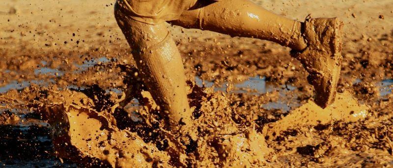 Rowlett kid playing in mud.